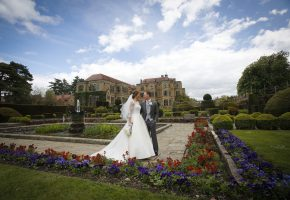 bride and groom in the gardens at Fanhmas Hall
