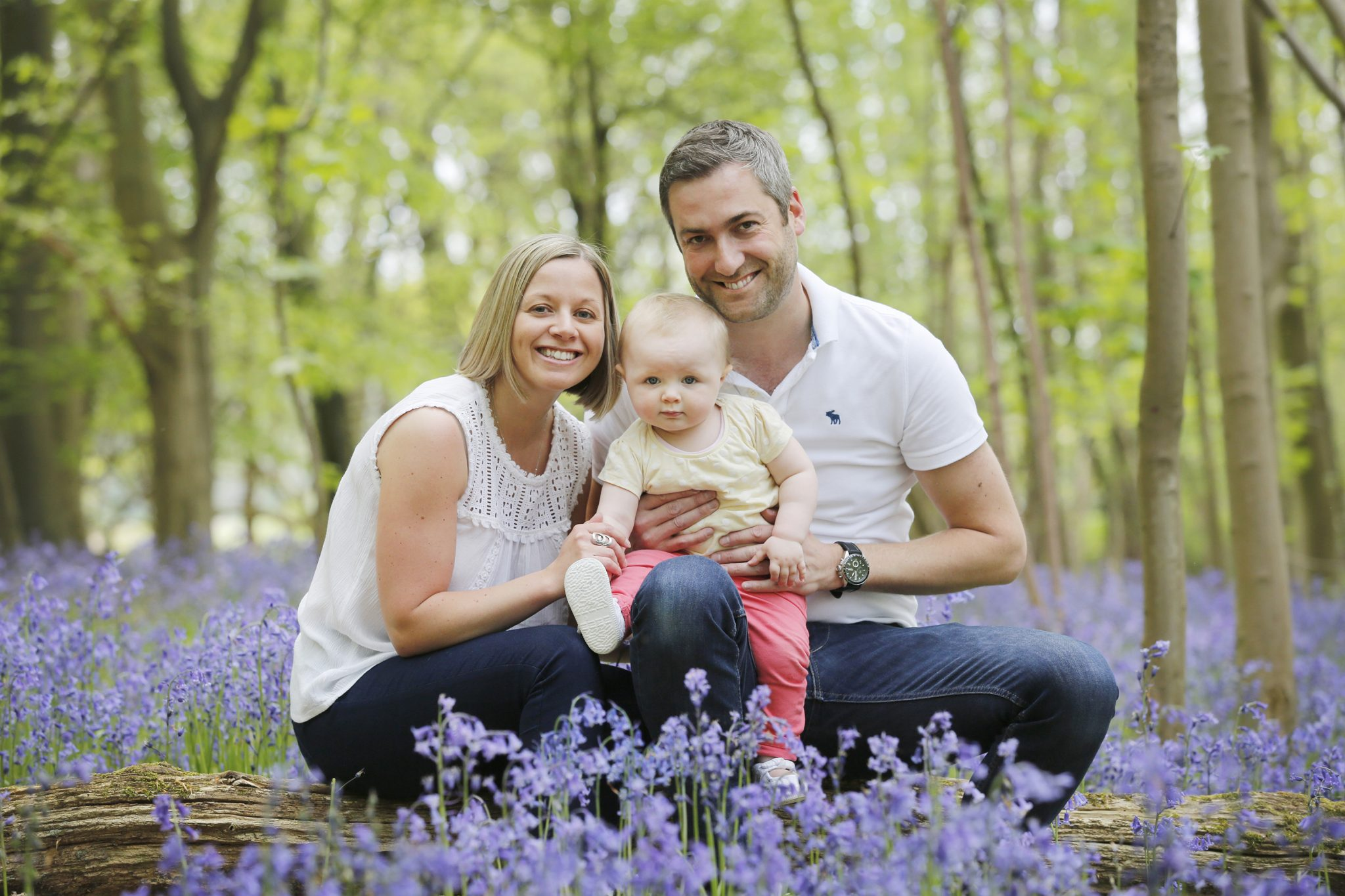 Family photographed in bluebell wood