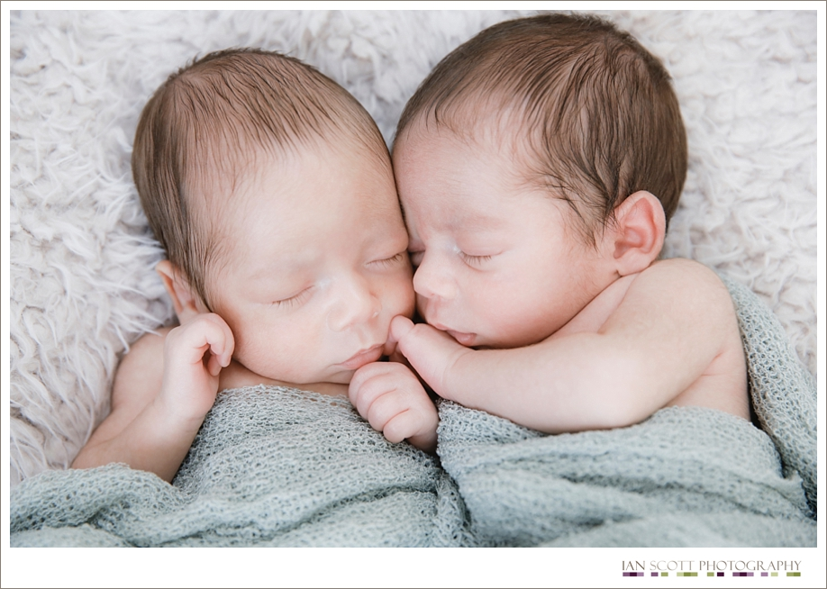 newborn twins sleeping together