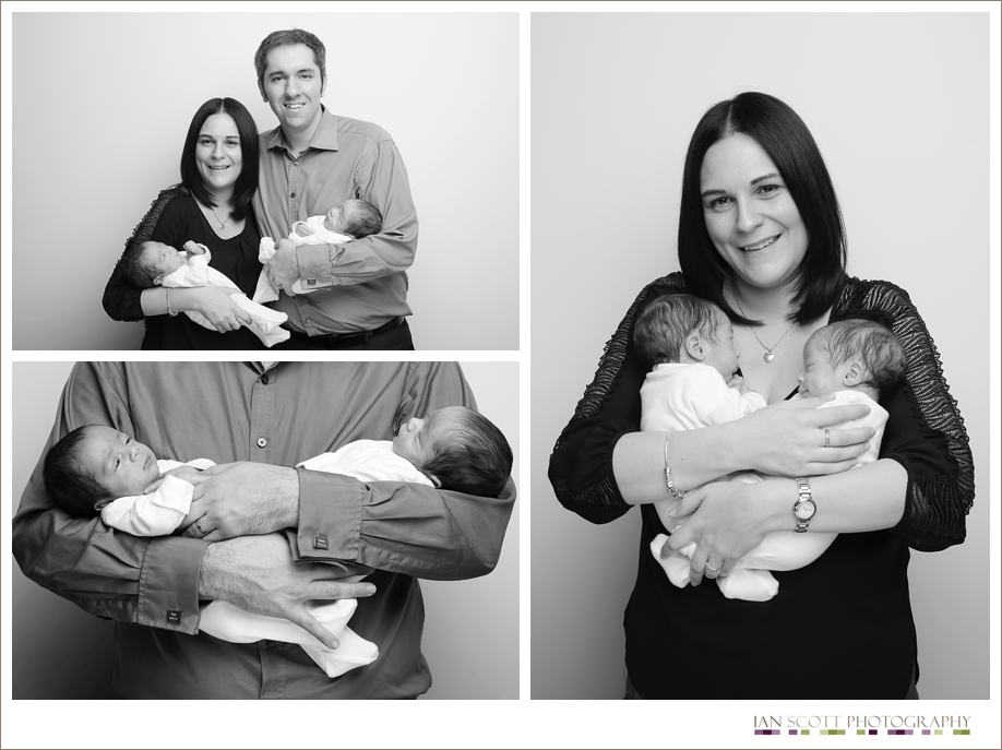 parents holding newborn twin boys