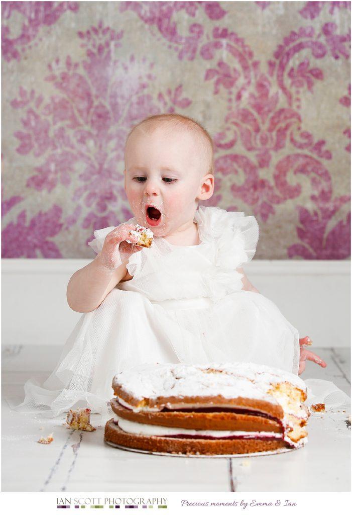 toddler eating cake